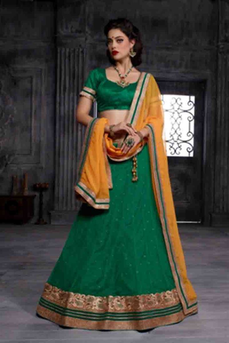 Compelling Bottle Green Heavy Embroidered Soft Net Bridal Wear Lehenga Choli With Blouse Designs